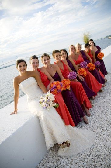 Feel free to mix-and-match different styles for the bridesmaids dresses. Lovely idea for a beach wedding!
