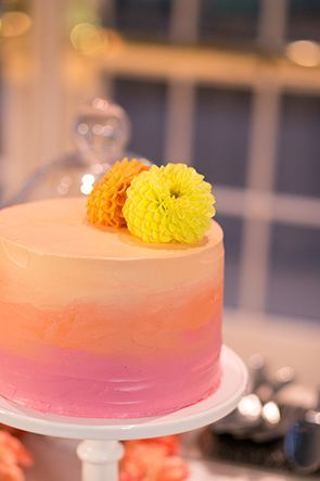 Add a pop of color to your wedding with this ombre buttercream cake!