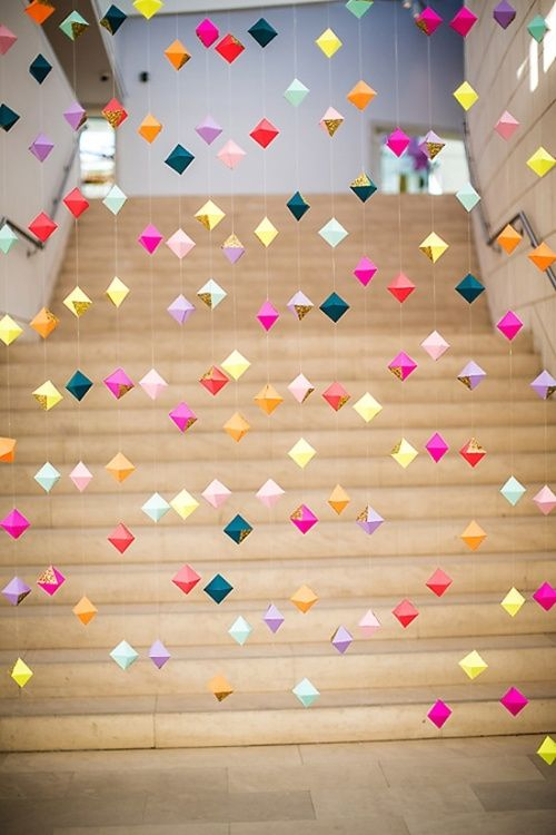 If you are into origami you can thread these delicate creations to make a wedding backdrop that is fire.