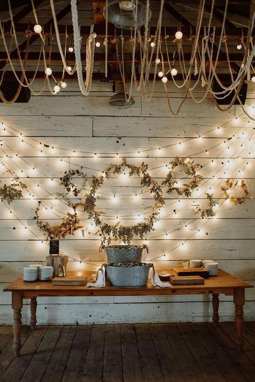 Twinkle lights and wedding wreath backdrop for the dessert table.