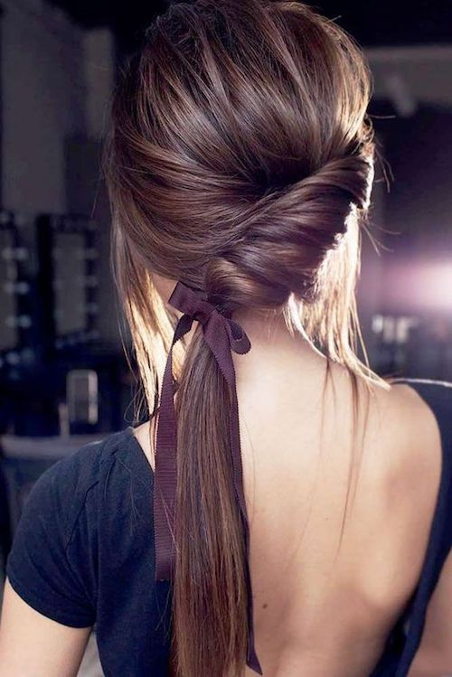 Twisted ponytail hairstyle, sleek and trending.