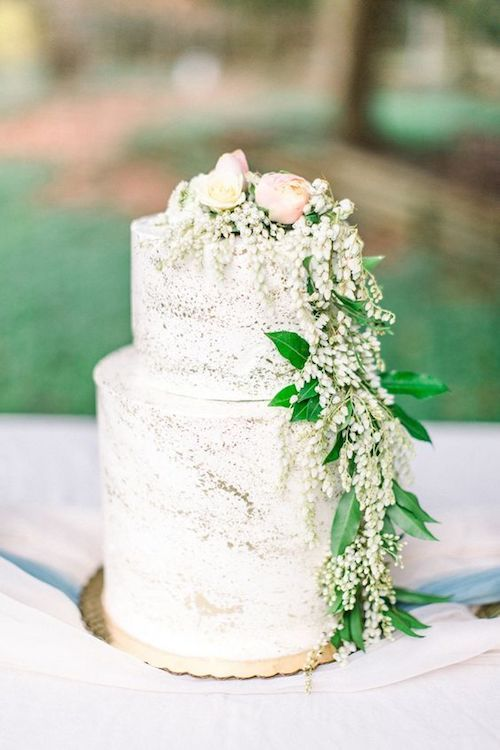 Petit wedding cake with gold splatter.