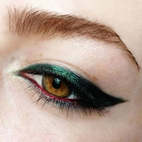 Winged colored liner.
