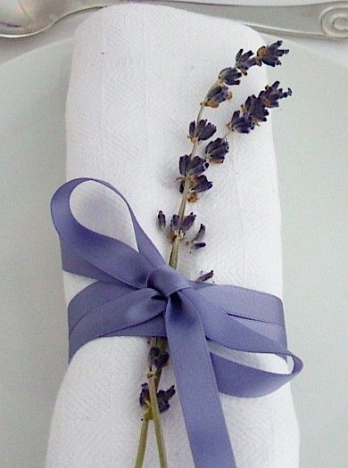 The devil is in the details. Tie a twig of lavender to the napkins. Voila! Backyard wedding ideas on a budget.