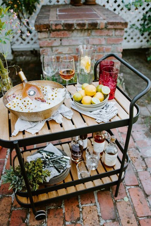 Get ready to party! Style up your bar cart. Check out the floral ice cubes. Photo: cheetahisthenewblack.