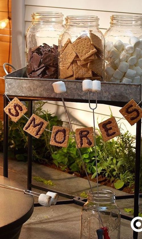 A fall backyard wedding would not be one without a S'mores station. Graham crackers, giant marshmallows and Hershey's bars in jars. No bugs allowed.
