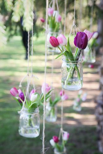 A few delicate and creative hanging summer flowers to make your home sing for your backyard wedding.