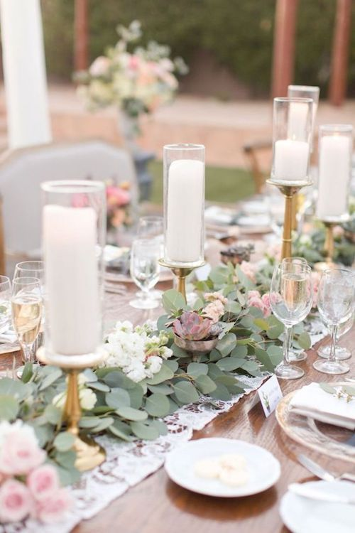 Reception with long wooden tables set with lace linings and a mix of eucalyptus runners, flowers, and succulents. Amy and Jordan Photography, Arizona.