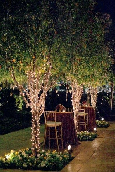 Wrap your trees in string lights and add a few tall tables. Downright fab.