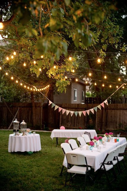 Folding tables and chairs, string lights and buntings for a very festive wedding in your own backyard.