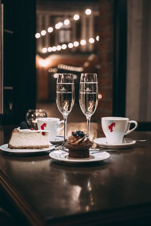 Two champagne flute glasses coffee and cake. A welcome stop in between your reception and your wedding night. Photo: Davids Kokainis.