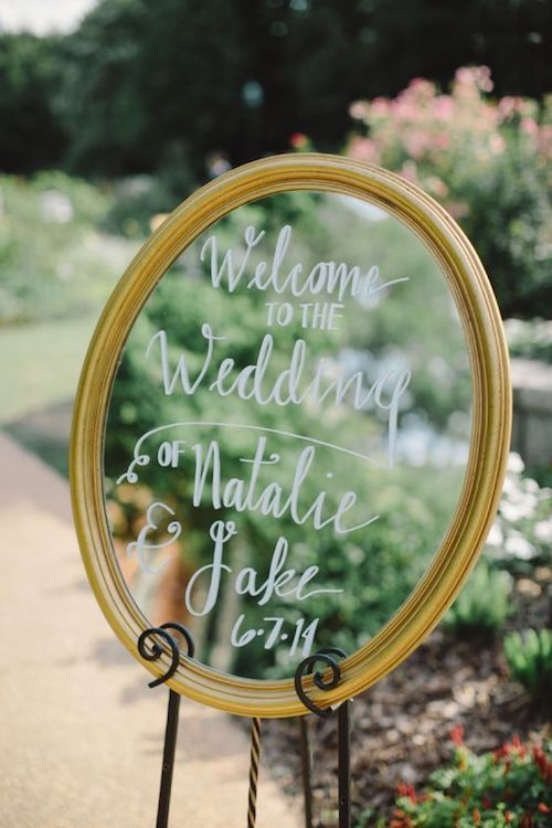Sometimes a mirror becomes a welcome sign to your cute backyard wedding.