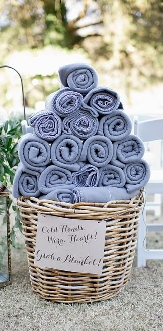 Add a cute little note to your blanket basket. Check out these winter backyard wedding ideas.