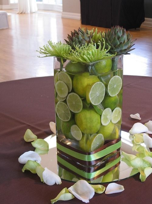 Limes and artichokes for a fresh, original and budget-friendly centerpiece you will want to take home with you!