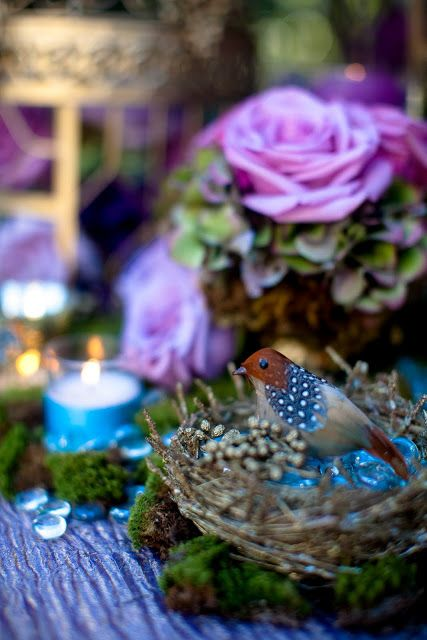 Lovely and romantic centerpiece for an enchanted forest wedding theme.