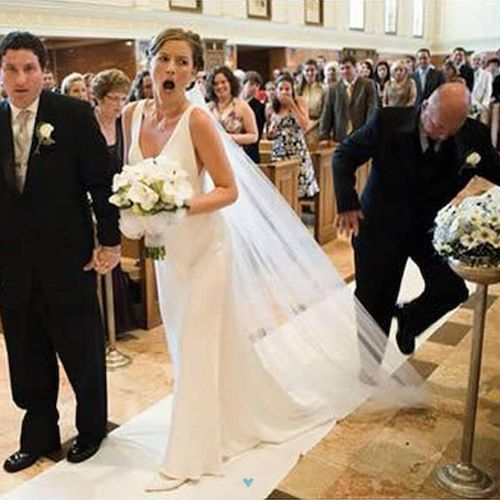 A fail that is more common than you think. Unless you want to be clobbered by a bridezilla, don't step on the bride's veil!