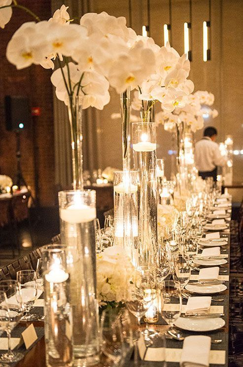 The elegance of white orchids and floating candles. Photographer: A Day of Bliss Photography.