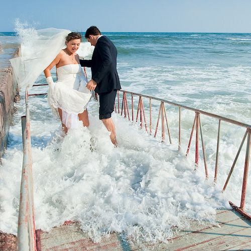 A bit farther away may not always be such a good idea. ;) Epic wedding photo fails.