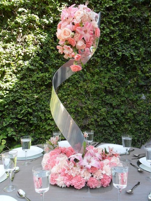 Spiral floral arrangement for wedding tables.