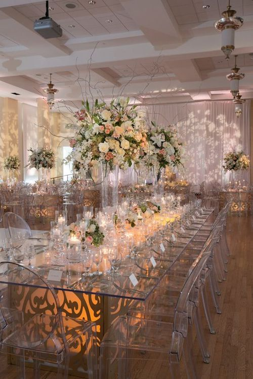 If you are going all out, get inspired by this magnificent mix of tall and short floral arrangements and centerpieces.