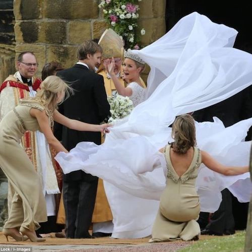 Avoid lots of flowy fabric if you are getting married in a windy location!