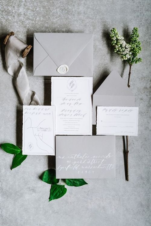 Give your guests a glimpse of what's to come with this chic and glamorous wedding invitation set.