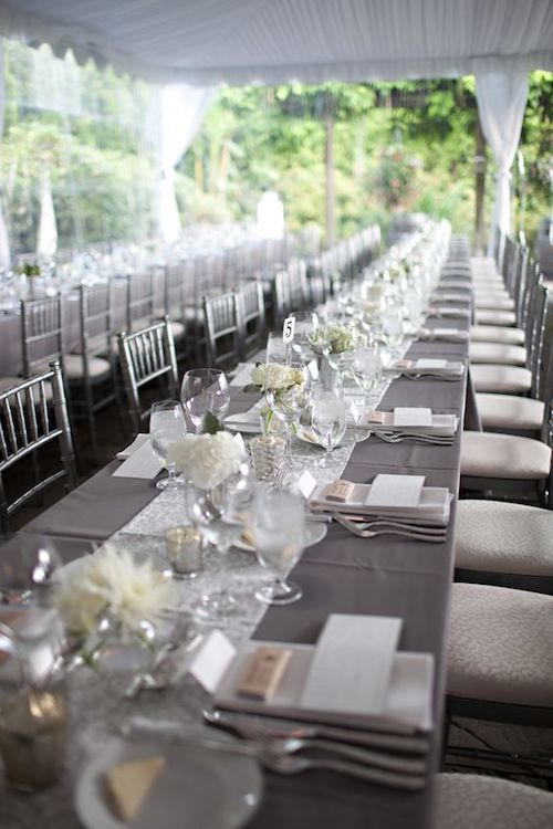 An elegant haven in gray and white against the greenery of your wedding venue by simplywed.