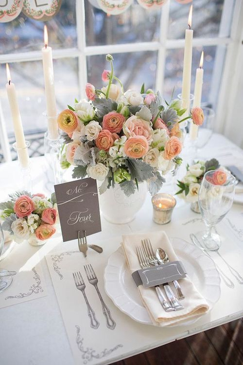 Colorful coral blooms, lush must-have gray details and one chic garden-like reception table. Photo: Millie Holloman+Jennifer Rose+Brent Holloman.