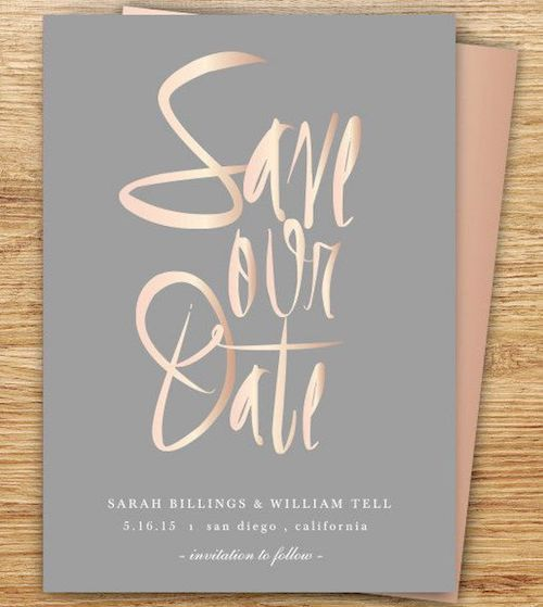 Copper and rose gold calligraphy on gray wedding invites.