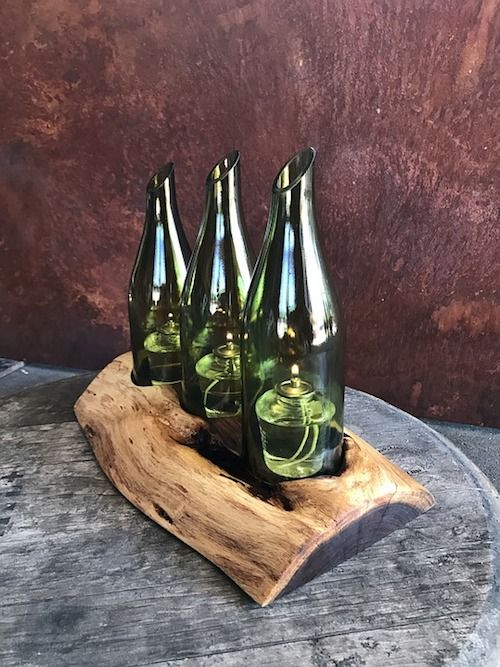 "Nautical-inspired centerpiece carved in driftwood with ""message in a bottle"" candle holders. This is definitely a keeper to decorate your home!"