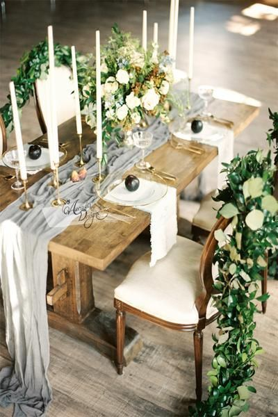 Add a touch of romantic elegance to your reception table with a silk gray chiffon table runner draped graciously across it.