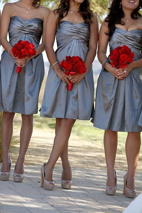 Red bridesmaid bouquets at a gray wedding. Stunning!