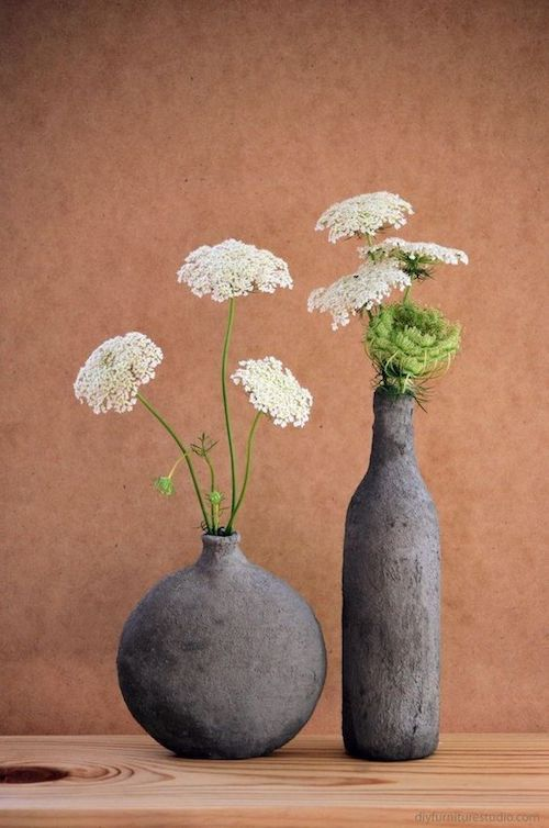 Turn bottles into cement vases. Ideal for a rustic, industrial or vintage wedding.
