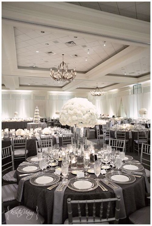 White centerpieces and charcoal gray and silver linens for a deluxe look. Photo: kristinviningphotoblog.