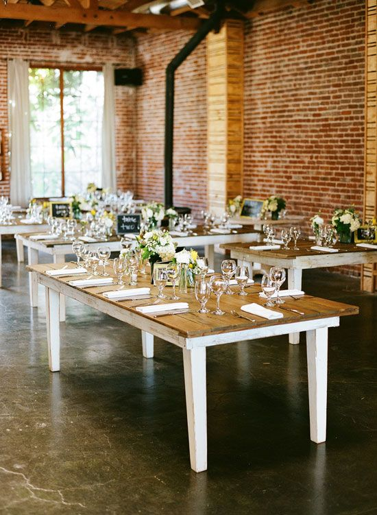 BOXeight, a spot-on Los Angeles venue. Reception catered buffet style, white and yellow flowers as centerpieces and mini chalkboard table numbers. Bright and cozy at the same time.