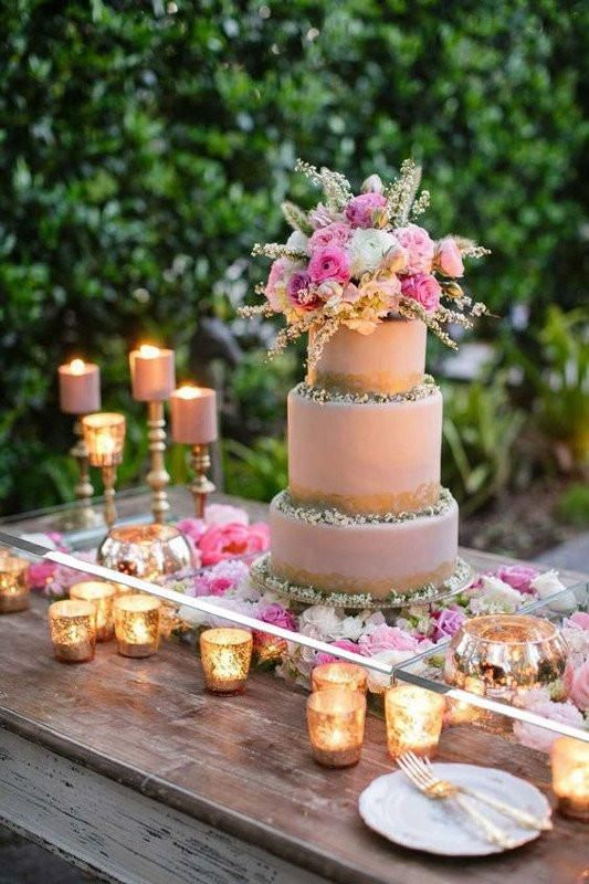 Make sure there is enough space on top of the votives so they don't heat up the acrylic cake table.