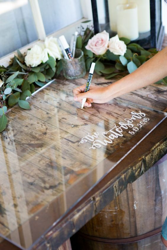 Definitely a unique guestbook idea. Have your guests sign this sheer acrylic and showcase it later as home decor. Via acreatedesign.