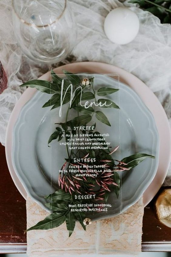 You can incorporate acrylic on your wedding menu or on the charger plates. Give your wedding decor a trending touch.