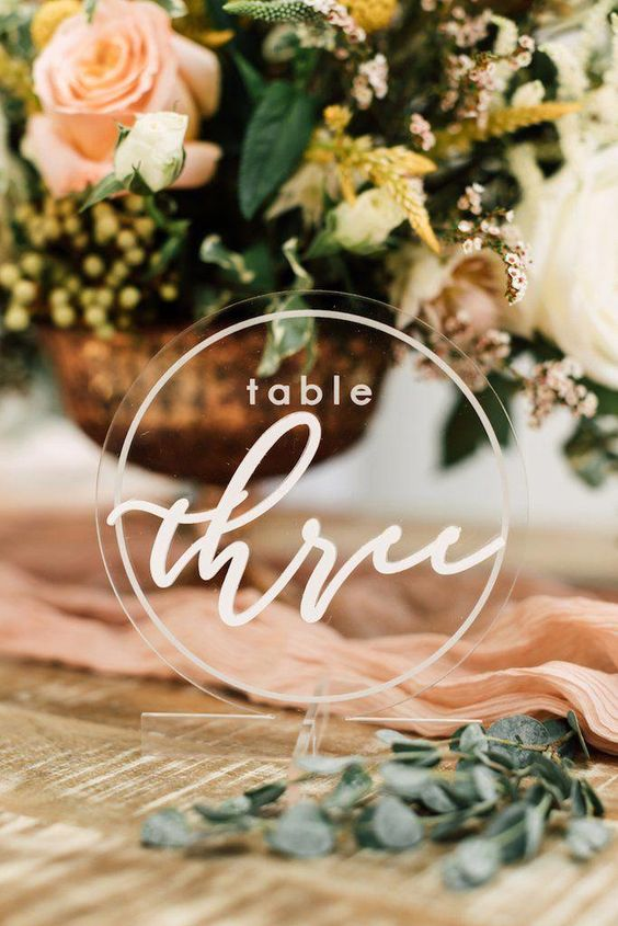 Glam and modern acrylic table numbers with white calligraphy via hapilyeveretched.
