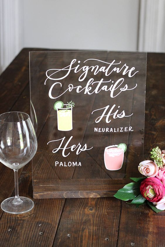 DIY a lucite or acrylic wedding sign for your signature drinks with the cutest visuals. Via Etsy from Lithia, Florida.