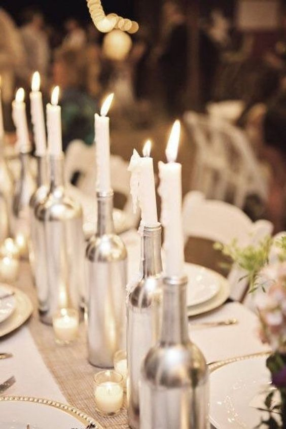 Loving these silver wine bottles. Perfect centerpiece to brighten up your industrial wedding soiree.