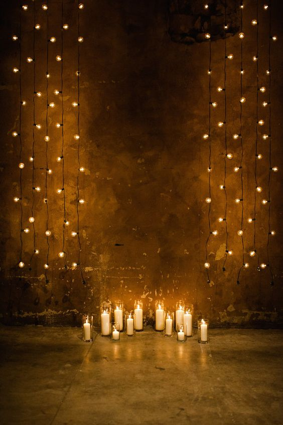 Hanging strings of light bulbs and candles make for both an impressive and budget-friendly ceremony background. Toronto Wedding at The Fermenting Cellar from Jenn and Dave Stark.