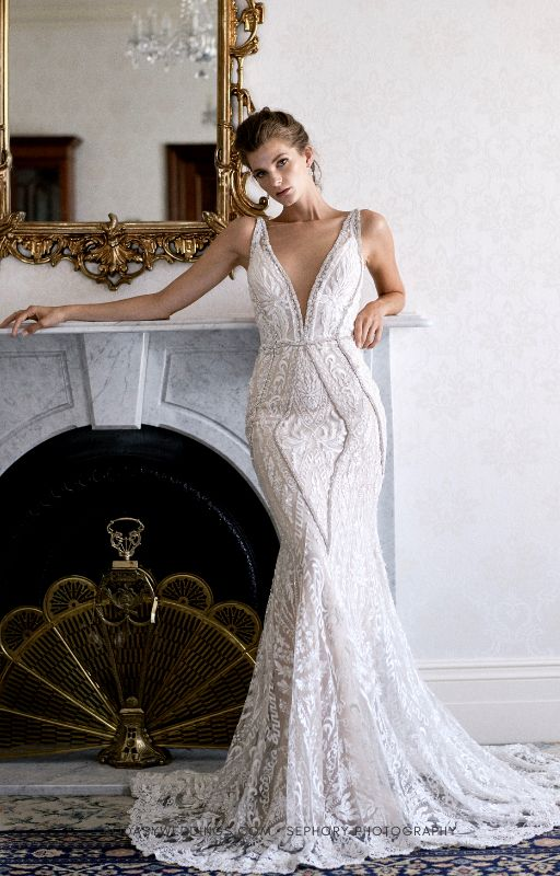 The design accentuates and highlights the bride's beautiful figure. Galia Lahav wedding dress.