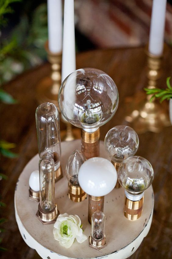 A centerpiece that doesn't need watering. Edison bulbs of all shapes and sizes. the more vintage or steampunk looking, the better.