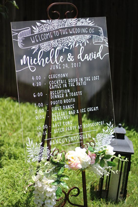 Welcome your guests with a timeline of your wedding and a beautiful clear acrylic wedding welcome sign. Get it on Etsy from Austin, TX.