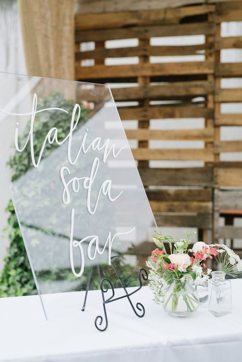 Welcome your guests to the soda bar with a fab clear lucite wedding sign.