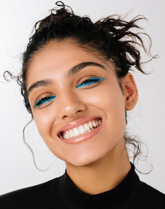 Try some colored eyeliner. Yas to blue for brown eyes!