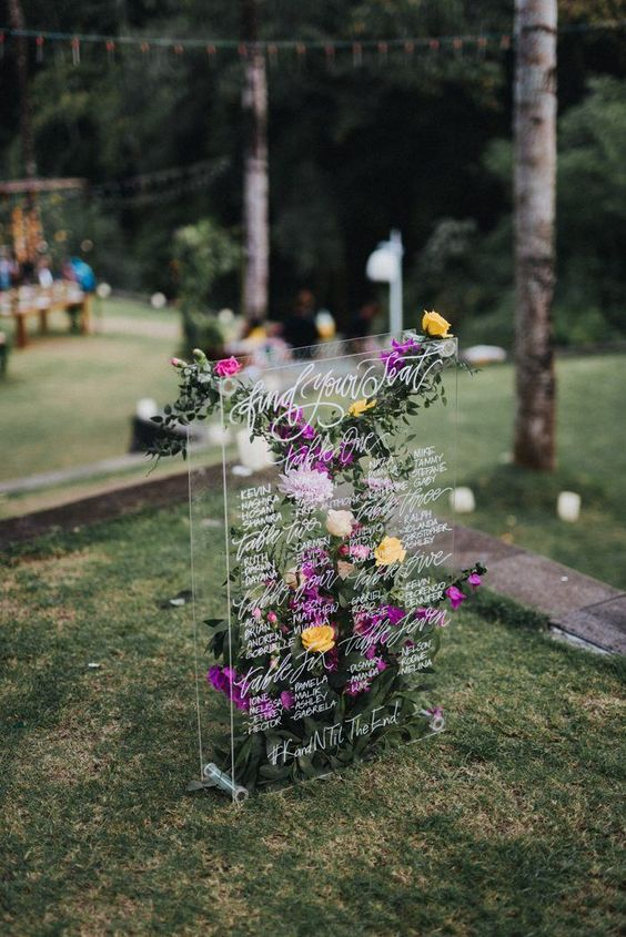 Swoon-worthy floral acrylic seating chart at a Sanctuary Bali Villa. Photo: Terralogical.
