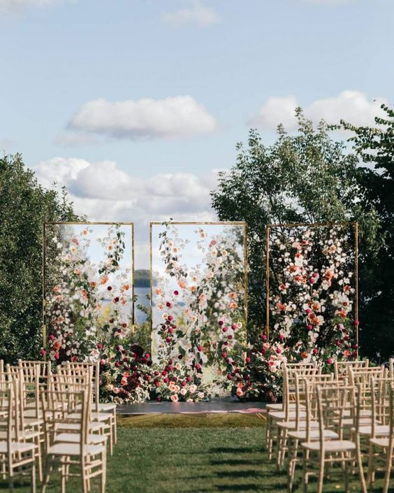 Creative floral acrylic wedding backdrop ideas.
