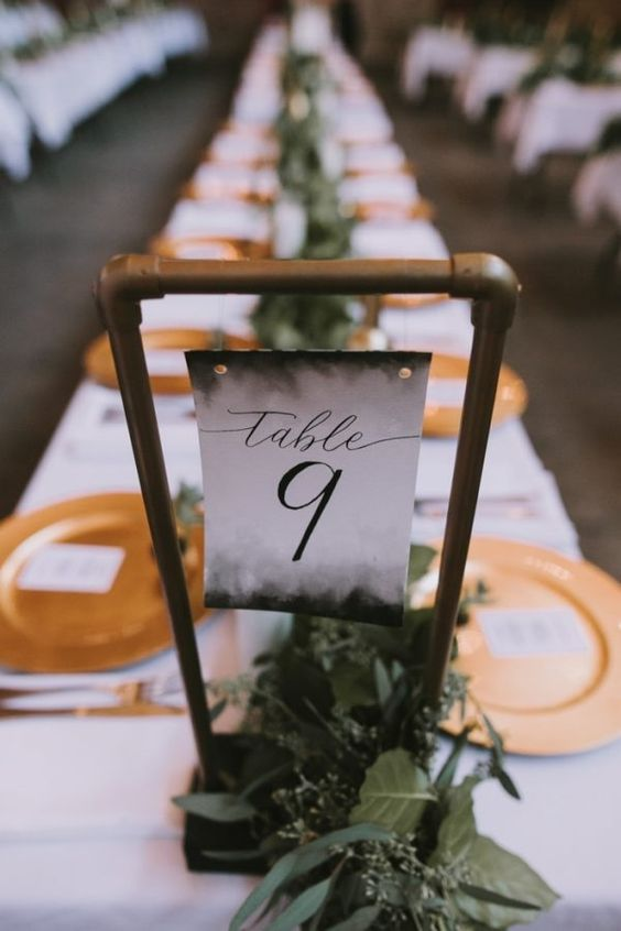 I dare you to DIY this galvanized pipe table number for an industrial warehouse venue! Rocking the aesthetic!